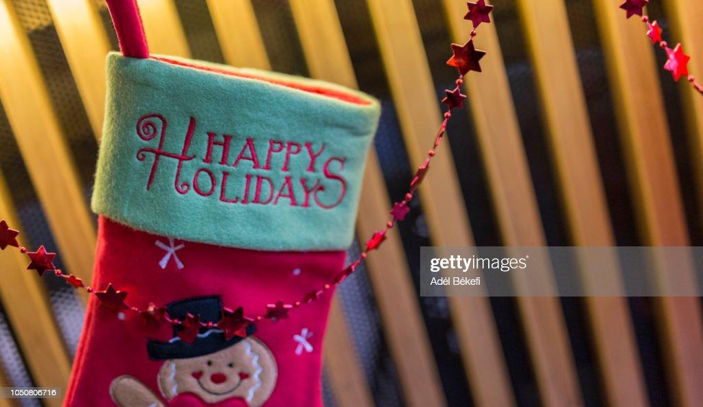 Santa boots detail with happy holidays text : Stock Photo