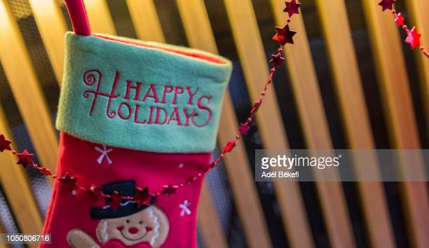 santa boots detail with happy holidays text - happy holidays stock photos and pictures