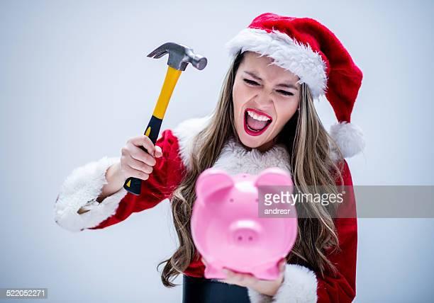 santa aufstellen ihr sparschwein - weihnachtsfrau stock-fotos und bilder