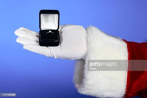 santa brings romance on blue - engagement ring box stock photos and pictures