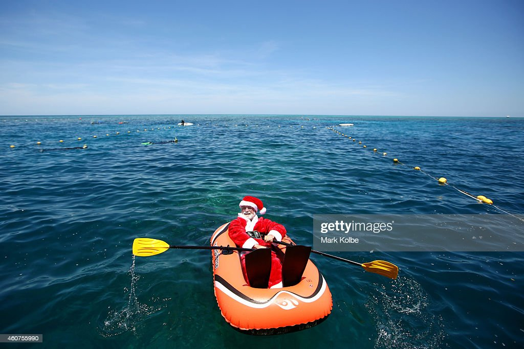 Santa can't help but have a quick swim and snorkel on the Great Barrier Reef with the clear blue skies and sunshine of Queensland, Australia. The Great Barrier Reef in Queensland Australia is the largest and most extensive coral reef system in the world comprising about 2,900 individual coral reefs, 600 continental islands and 300 coral cays. The Great Barrier Reef is the largest natural feature on earth and its impressive size makes it the only living structure that can be seen from the moon. The Great Barrier Reef is 2,300 kms long and approximately 350 000 kms? in size. Thats about 70 million football fields, or the size of Japan!