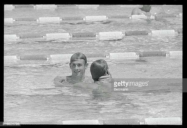 Santa Clara California Santa Clara Swim Classic Roland Matthes of East Germany is congratulated by Mitch Ivey Santa Clara after Matthes lowered his...