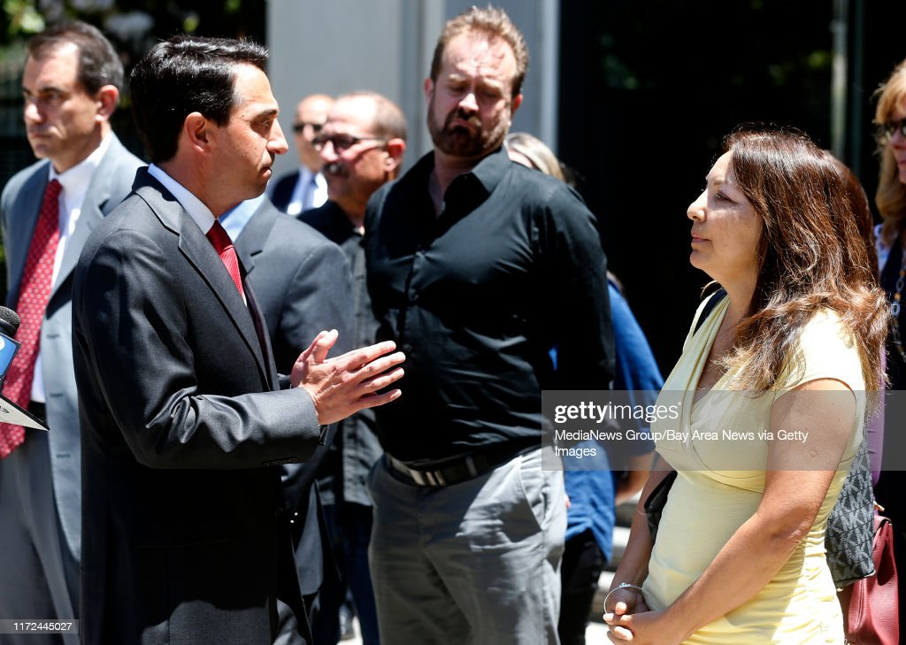 Santa Clara County District Attorney Jeff Rosen, left, talks with Marlene LaMar, right, after Antolin Garcia-Torres was sentenced to life in prison without parole for the killing  of missing teen Sierra LaMar on Monday, June 5, 2017, in San Jose, Calif. : News Photo