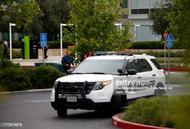 Santa Clara County Sheriff's deputies investigate a report of a body found at Apple headquarters Wednesday morning April 27 in Cupertino, Calif.