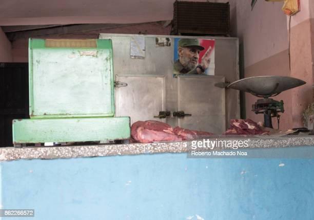 Santa Clara, Cuba: Butcher's shop with a photo of Fidel Castro in the old refrigerator.