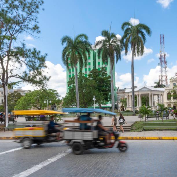 Santa Clara, Cuba, motion blur of 'motonetas' in the Leoncio Vidal Park