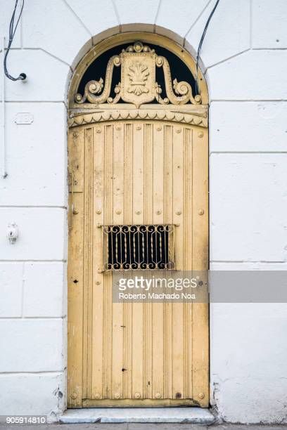 santa clara, cuba: old architectural details of a wooden door in the surrounding area of the leoncio vidal park - santa clara cuba stock pictures, royalty-free photos & images