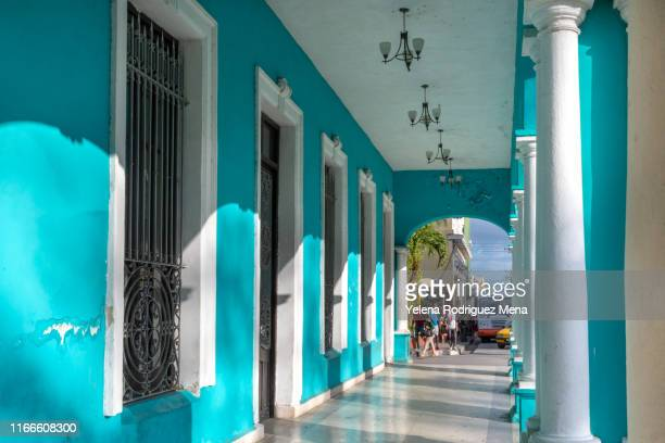 santa clara, cuba, pastel color colonial style building in the city center - santa clara cuba stock pictures, royalty-free photos & images