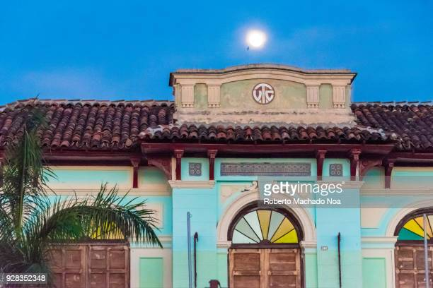 Santa Clara, Cuba: the full moon over the city old buildings during the blue hour