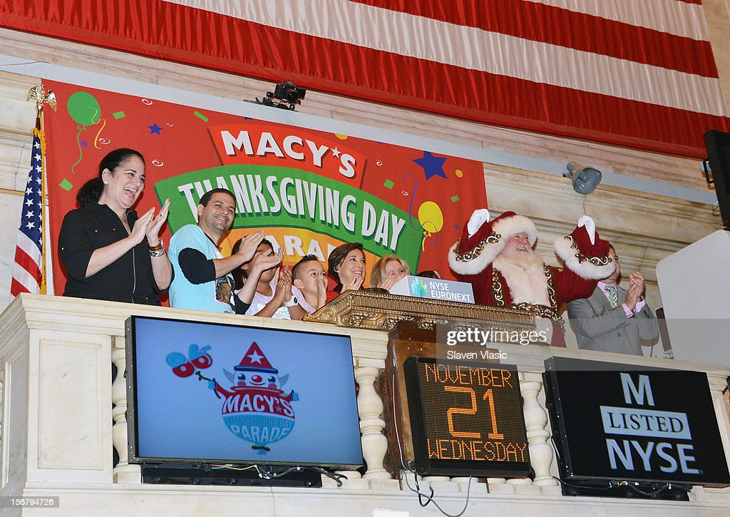 Santa Claus, Amy Kule (C), Executive Producer of Macy's Thanksgiving Day Parade and her Parade team ring The Opening Bell at the New York Stock Exchange to celebrate the 86th Annual Macy's Thanksgiving the New York Stock Exchange on November 21, 2012 in New York City.