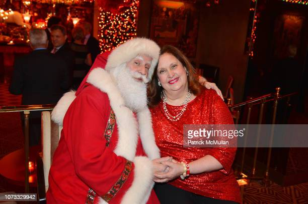 Santa Claus and Alison Mazzola attend George Farias Anne Jay McInerney Host A Holiday Party at The Doubles Club on December 13 2018 in New York City