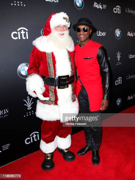 Santa Claus and Aloe Blacc attend Christmas at The Grove A Festive Tree Lighting celebration at The Grove on November 17 2019 in Los Angeles...