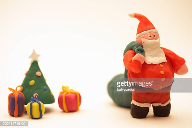 Santa Claus and bag of gifts with christmas tree and presents