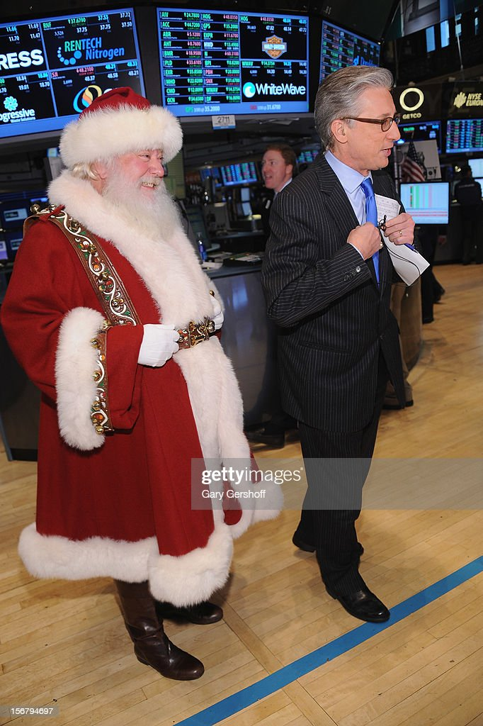 Santa Claus (L) and CNBC anchor Bob Pisani seen on the floor of the New York Stock Exchange on November 21, 2012 in New York City.