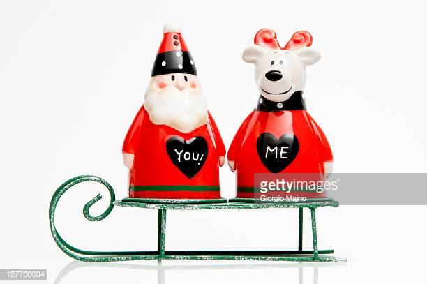 Santa Claus and companion on a sleigh.