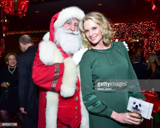 Santa Claus and Debbie Loeffler attend A Christmas Cheer Holiday Party 2017 Hosted by George Farias and Anne and Jay McInerney at The Doubles Club on...
