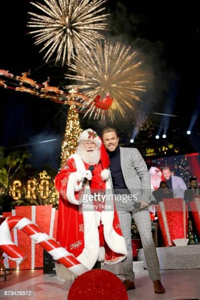 Santa Claus and Derek Hough perform onstage at A California Christmas at the Grove Presented by Citi on November 12 2017 in Los Angeles California