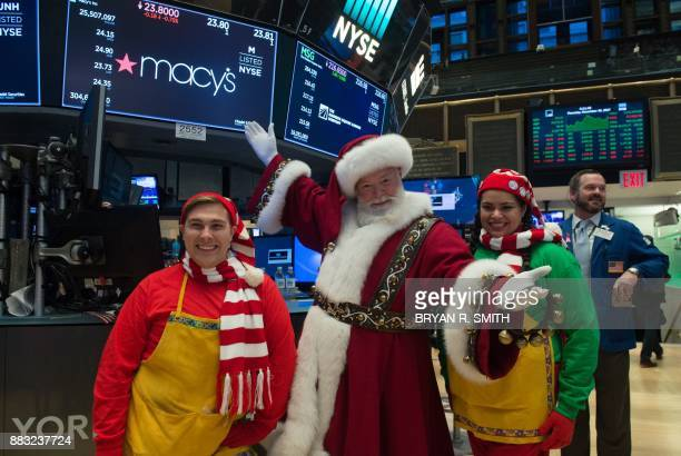 'Santa Clause' and elves are seen on the floor on the floor at the closing bell of the Dow Industrial Average at the New York Stock Exchange on...