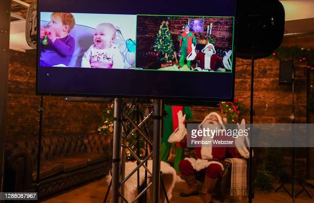 Santa Claus and his elf Pipkin talk to children on Zoom on November 27, 2020 in Newquay, England. A new partnership between Santa Claus and...