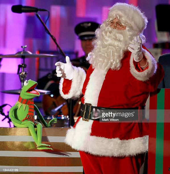 Santa Claus and Kermit the frog sing a song during the National Christmas Tree lighting ceremony on December 1 2011 at the Ellipse south of the White...
