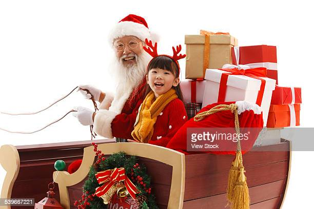 Santa Claus and little girl on Christmas