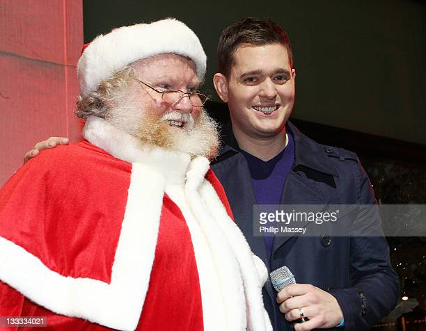 Santa Claus and Michael Buble attend the launch of Brown Thomas' Christmas windows on November 18, 2011 in Dublin, Ireland.