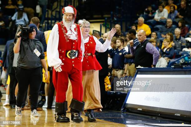 Santa Claus and Mrs Claus greet fans during the annual Teddy Bear Toss during a timeout during the first half of a regular season nonconference game...