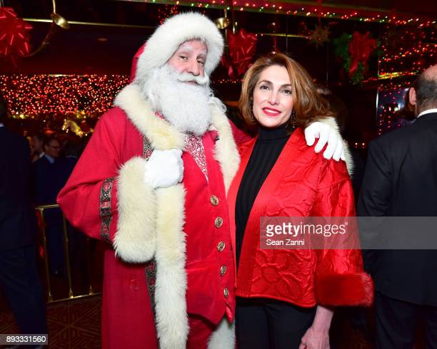 Santa Claus and Natalie de Gunzburg attend A Christmas Cheer Holiday Party 2017 Hosted by George Farias and Anne and Jay McInerney at The Doubles...