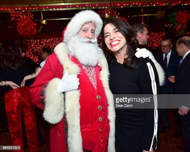 Santa Claus and Sandra Ripert attend A Christmas Cheer Holiday Party 2017 Hosted by George Farias and Anne and Jay McInerney at The Doubles Club on...