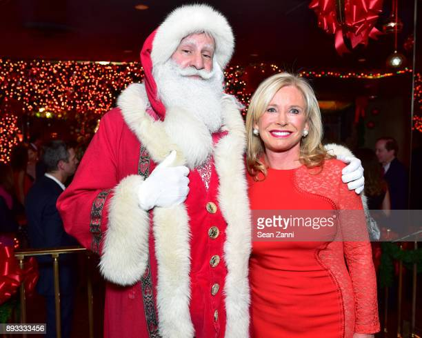 Santa Claus and Sharon Bush attend A Christmas Cheer Holiday Party 2017 Hosted by George Farias and Anne and Jay McInerney at The Doubles Club on...
