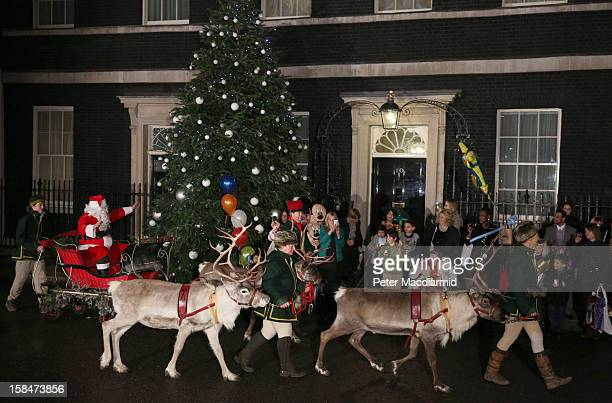Santa Claus appears with sleigh and reindeer during a Christmas party hosted for sick children at 10 Downing Street on December 17 2012 in London...