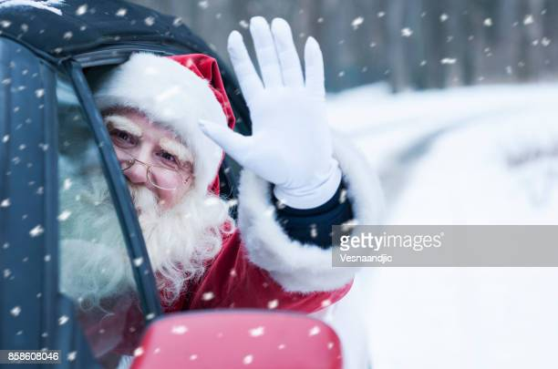 santa claus at car - santa stock pictures, royalty-free photos & images