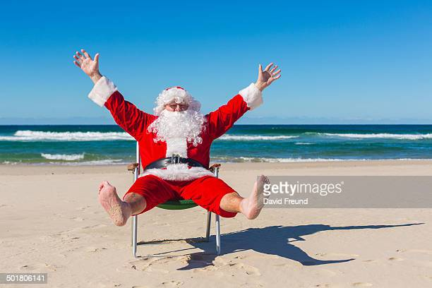 santa claus at the beach - david freund stock pictures, royalty-free photos & images