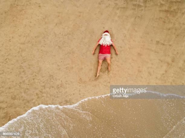 Santa Claus at the beach