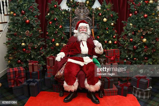 Santa Claus attends an evening hosted by Brooks Brothers to celebrate the holidays with St Jude Children's Research Hospital at Brooks Brothers on...