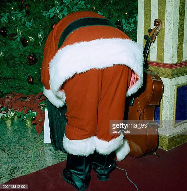 Santa Claus bending over, rear view