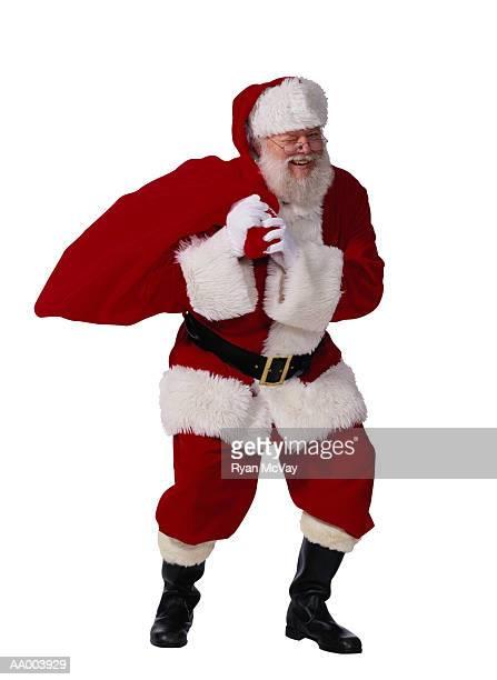 Santa Claus Carrying a Bag of Christmas Gifts