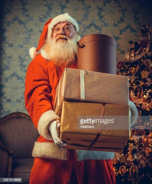 Santa Claus carrying gifts