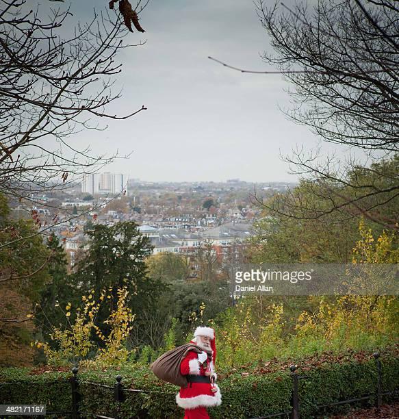 Santa Claus carrying sack over shoulder