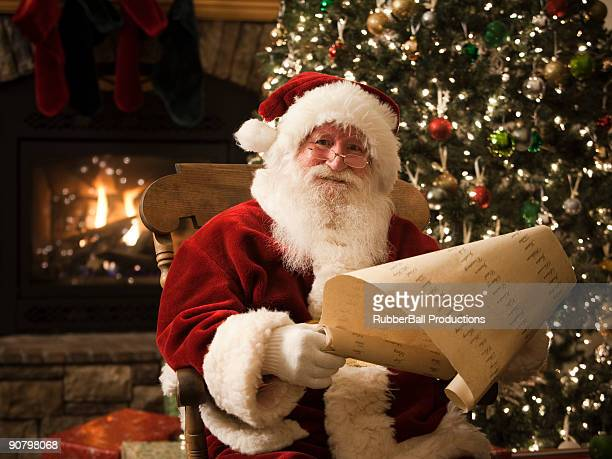 santa claus checking his list - orem utah stock pictures, royalty-free photos & images