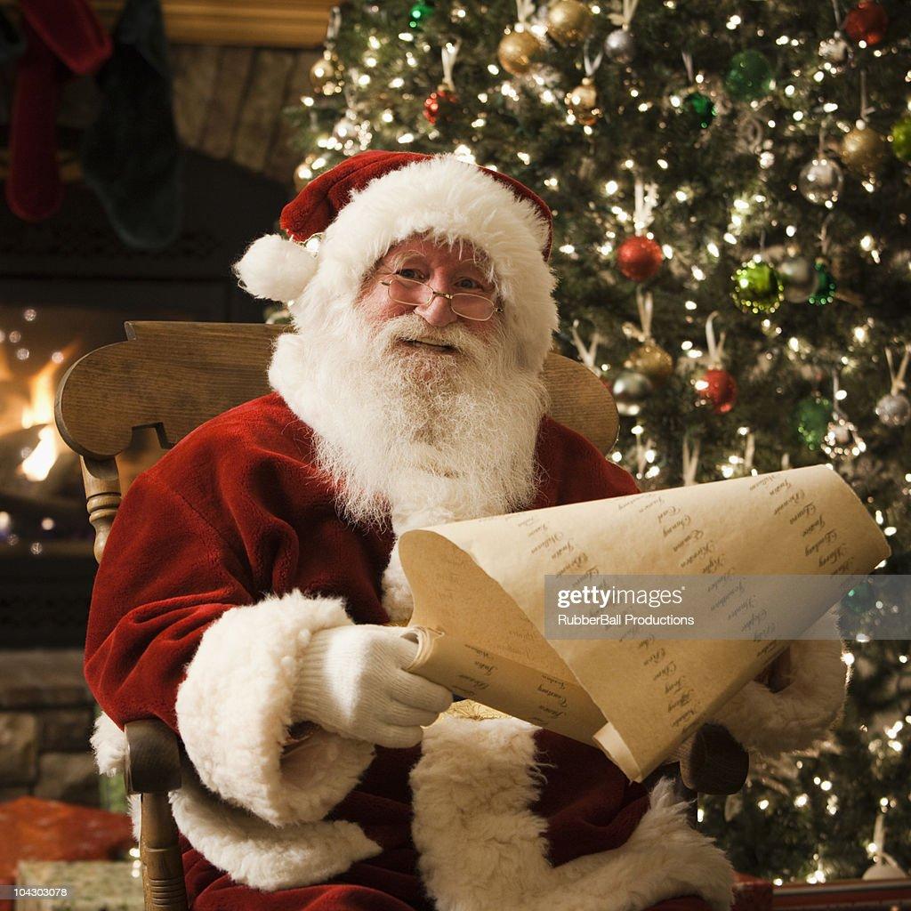santa claus checking his naughty and nice list : Stock Photo