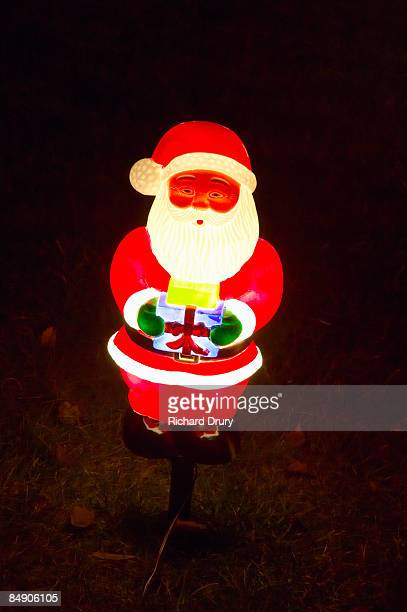santa claus christmas ornament in garden - richard drury stock pictures, royalty-free photos & images