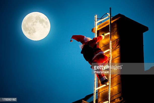 santa claus climbing up a chimney - ladder to the moon stock pictures, royalty-free photos & images