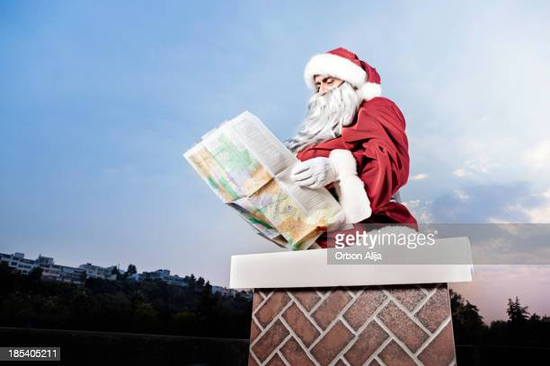 Santa Claus consulting a map