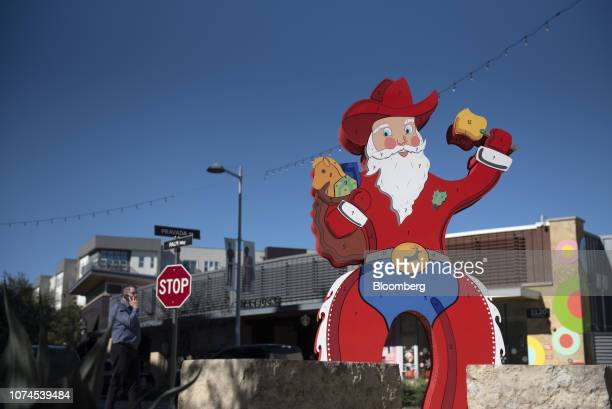 A Santa Claus cowboy statue stands at the Domain shopping center in Austin Texas US on Thursday Dec 20 2018 Apple Inc announced this month it's...
