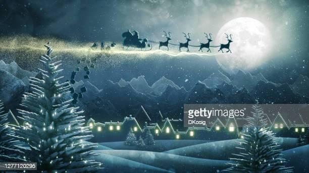 de kerstman die kerstmis presenteert bij nacht levert - dorp stockfoto's en -beelden