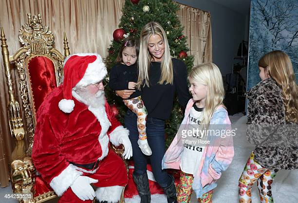 Santa Claus Denise Richards Eloise Richards Lola Sheen and Sam Sheen attend the 3rd Annual Santa's Secret Workshop Benefiting LA Family Housing at...