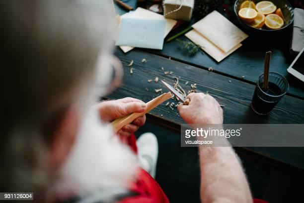 santa claus doing wood work - santas workshop stock photos and pictures