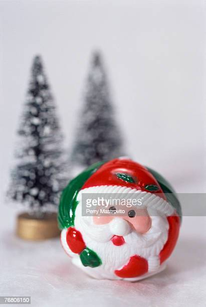 santa claus figurine, toy trees in background - mamma natale foto e immagini stock