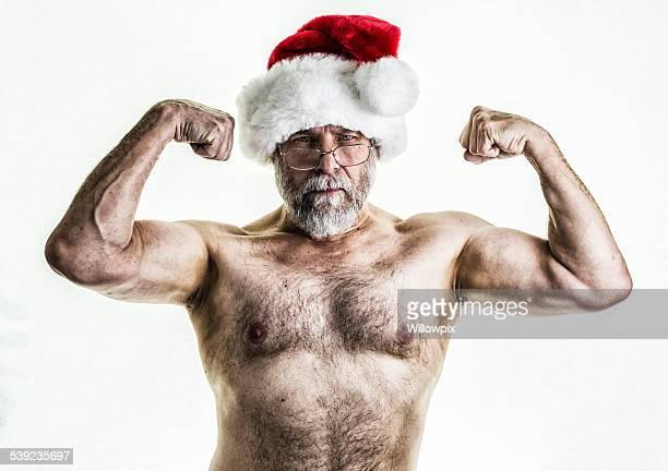 santa claus flexing muscles - ontbloot bovenlichaam stockfoto's en -beelden